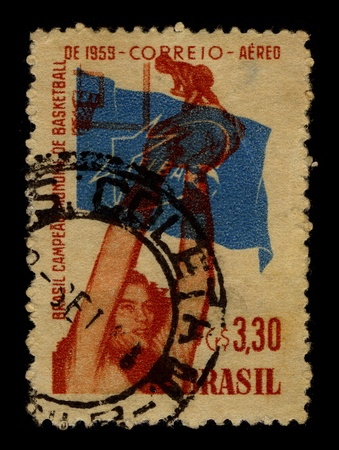 BRAZIL-CIRCA 1959:A stamp printed in BRAZIL shows image of the Basketball is a team sport in which two teams of five players try to score points by throwing or