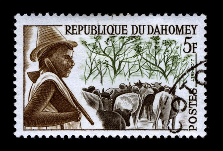 REPUBLIQUE DU DAHOMEY-CIRCA 1968:A stamp printed in REPUBLIQUE DU DAHOMEY shows image of the Livestock in Africa, circa 1968. Stock Photo - 9272153