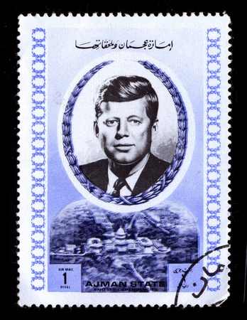 john: AJMAN-CIRCA 1970:A stamp printed in AJMAN shows image of John Fitzgerald Jack Kennedy, often referred to by his initials JFK, was the 35th President of the United States, serving from 1961 until his assassination in 1963, circa 1970.