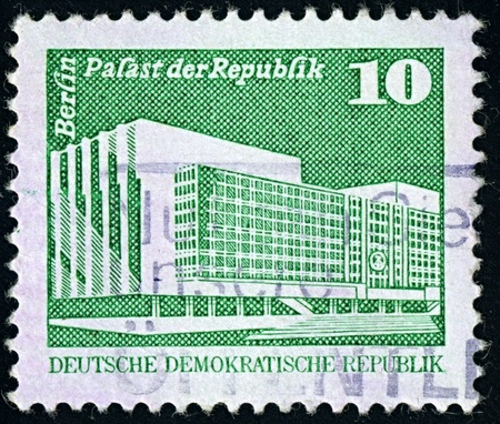 people's cultural palace: DDR-CIRCA 1980:A stamp printed in DDR shows image of The Palace of the Republic in Berlin was the seat of the parliament of the German Democratic Republic, the People