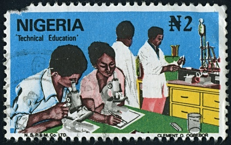 perforated stamp: NIGERIA-CIRCA 1970:A stamp printed in NIGERIA shows image of Technical Education of Nigeria, circa 1970. Stock Photo