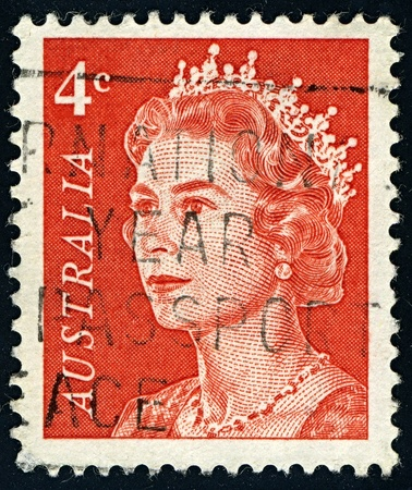 constitutional: AUSTRALIA-CIRCA 1966:A stamp printed in AUSTRALIA shows image of Elizabeth II (Elizabeth Alexandra Mary, born 21 April 1926) is the constitutional monarch of United Kingdom in orange, circa 1966.