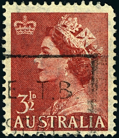 AUSTRALIA-CIRCA 1953:A stamp printed in AUSTRALIA shows image of Elizabeth II (Elizabeth Alexandra Mary, born 21 April 1926) is the constitutional monarch of United Kingdom in brown, circa 1953.