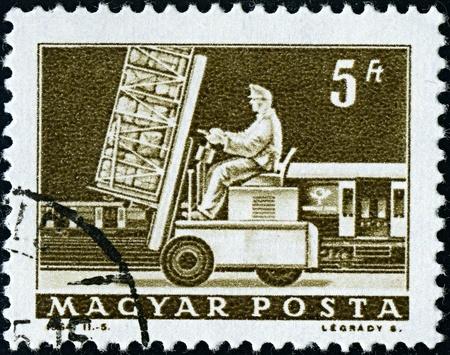 mailmen: HUNGARY-CIRCA 1964:A stamp printed in HUNGARY shows image of postal loader, circa 1964.