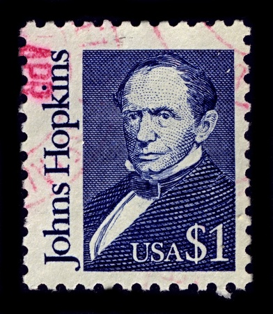 abolitionist: USA-CIRCA 1989:A stamp printed in USA shows image of Johns Hopkins was a wealthy American entrepreneur, philanthropist and abolitionist of 19th-century Baltimore, Maryland, circa 1989.