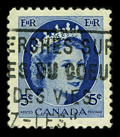 alexandra: CANADA-CIRCA 1954:A stamp printed in CANADA shows image of Elizabeth II (Elizabeth Alexandra Mary, born 21 April 1926) is the constitutional monarch of United Kingdom in blue, circa 1954. Editorial