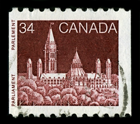 CANADA-CIRCA 1985:A stamp printed in CANADA shows image of Parliament Hill, colloquially known as The Hill, is an area of Crown land on the southern banks of the Ottawa River in downtown Ottawa, Ontario, circa 1985. Stock Photo - 10067784