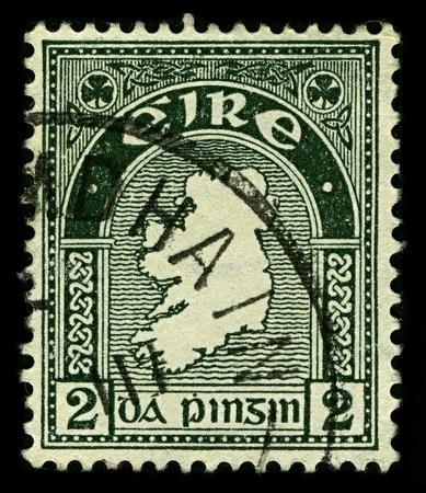IRELAND-CIRCA 1922:A stamp printed in IRELAND shows image of national symbols of Ireland, circa 1922.