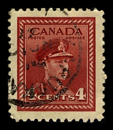dominions: CANADA-CIRCA 1942:A stamp printed in CANADA shows image of George VI  was King of the United Kingdom and the Dominions of the British Commonwealth from 11 December 1936 until his death, circa 1942.