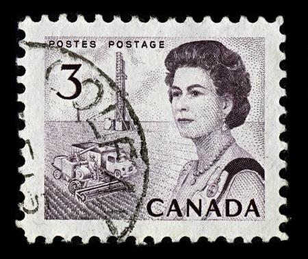 realms: CANADA-CIRCA 1967:A stamp printed in CANADA shows image of Elizabeth II (Elizabeth Alexandra Mary, born 21 April 1926) is the constitutional monarch of United Kingdom, circa 1967. Editorial