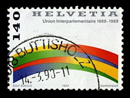 frederic: Suiza-alrededor de 1989:A sello impreso en Suiza muestra imagen de la Uni�n Interparlamentaria (UIP) es una organizaci�n internacional establecida en 1889 por William Randal Cremer y Frederic Passy, alrededor de 1989. Editorial