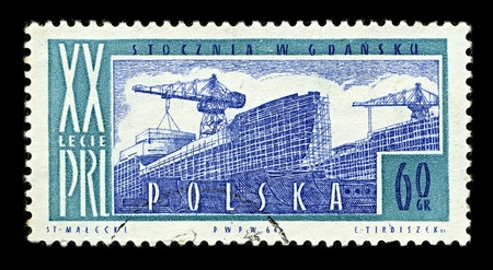 POLAND-CIRCA 1964:A stamp printed in POLAND shows image of Gdansk Shipyard (Stocznia Gdansk) is a large Polish shipyard, located in the city of Gdansk, circa 1964. Stock Photo - 10166037