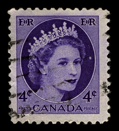 canada stamp: CANADA-CIRCA 1954:A stamp printed in CANADA shows image of Elizabeth II (Elizabeth Alexandra Mary, born 21 April 1926) is the constitutional monarch of United Kingdom in blue, circa 1954. Editorial