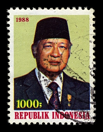 sukarno: INDONESIA-CIRCA 1988:A stamp printed in INDONESIA shows image of Suharto was the second President of Indonesia, having held the office for 32 years from 1967 following Sukarnos removal until his resignation in 1998, circa 1988.