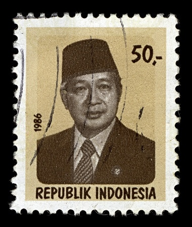 sukarno: INDONESIA-CIRCA 1986:A stamp printed in INDONESIA shows image of Suharto was the second President of Indonesia, having held the office for 32 years from 1967 following Sukarnos removal until his resignation in 1998, circa 1986.