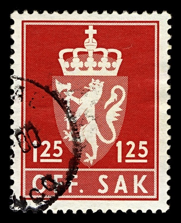 argent: NORWAY-CIRCA 1975:A stamp printed in NORWAY shows image of The coat of arms of Norway is a crowned, golden lion rampant holding an axe with an argent blade, on a crowned, triangular and red escutcheon, circa 1975.