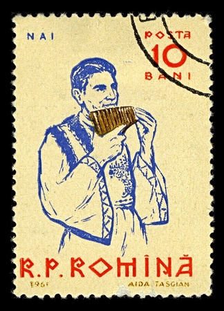 ROMANIA-CIRCA 1961:A stamp printed in ROMANIA shows image of The pan flute or pan pipe (also known as panflute or panpipes) is an ancient musical instrument based on the principle of the closed tube, circa 1961. Stock Photo - 10321636