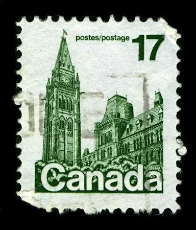 parlamentario: Canad�-alrededor de 1979:A sello impreso en Canad� muestra imagen de el bloque de Centro (en franc�s: du centre de edificio) es el edificio principal del complejo parlamentario canadiense en la colina del Parlamento, en Ottawa, Ontario, alrededor de 1979.