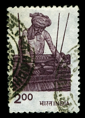 distinct: INDIA-CIRCA 1980:A stamp printed in INDIA shows image of Weaving is a textile craft in which two distinct sets of yarns or threads are interlaced to form a fabric or cloth, circa 1980.