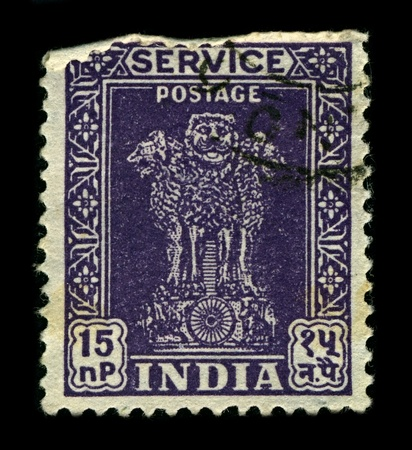INDIA-CIRCA 1957:A stamp printed in INDIA shows image of The emblem of India is an adaptation of the Sarnath Lion Capital of Ashoka, circa 1957.