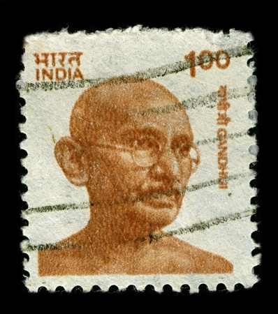 perforated stamp: INDIA-CIRCA 1991:A stamp printed in INDIA shows image of Mohandas Karamchand Gandhi was the pre-eminent political and ideological leader of India during the Indian independence movement, circa 1991. Editorial