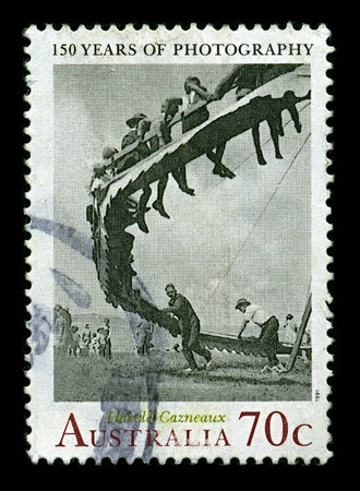AUSTRALIA-CIRCA 1991:A stamp printed in AUSTRALIA shows image of Harold Cazneaux was and Australian pictorialist photographer; a pioneer whose style had an indelible impact on the development of Australian photographic history, circa 1991. Stock Photo - 10354436