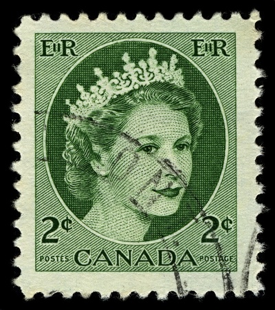 CANADA-CIRCA 1954:A stamp printed in CANADA shows image of Elizabeth II (Elizabeth Alexandra Mary, born 21 April 1926) is the constitutional monarch of United Kingdom in green, circa 1954.