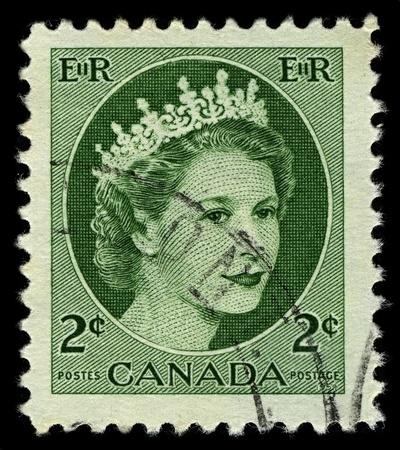 alexandra: CANADA-CIRCA 1954:A stamp printed in CANADA shows image of Elizabeth II (Elizabeth Alexandra Mary, born 21 April 1926) is the constitutional monarch of United Kingdom in green, circa 1954.