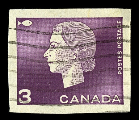 alexandra: CANADA-CIRCA 1962:A stamp printed in CANADA shows image of Elizabeth II (Elizabeth Alexandra Mary, born 21 April 1926) is the constitutional monarch of United Kingdom in violet, circa 1962.