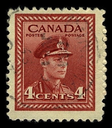 dominions: CANADA-CIRCA 1942:A stamp printed in CANADA shows image of George VI (Albert Frederick Arthur George) was King of the United Kingdom and the Dominions of the British Commonwealth, circa 1942. Editorial