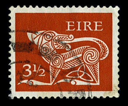 IRELAND-CIRCA 1971:A stamp printed in IRELAND shows image of Dog part of an old Irish decorative brooch, circa 1971.