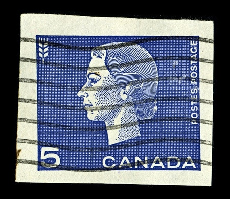alexandra: CANADA-CIRCA 1962:A stamp printed in CANADA shows image of Elizabeth II (Elizabeth Alexandra Mary, born 21 April 1926) is the constitutional monarch of United Kingdom, circa 1962.