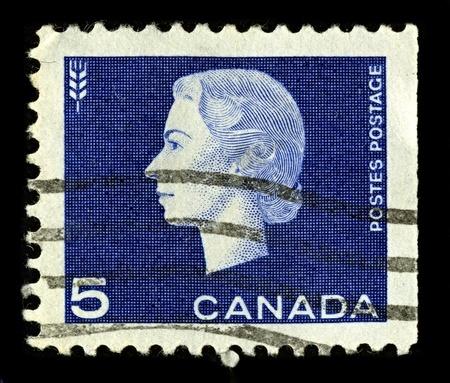 alexandra: CANADA-CIRCA 1962:A stamp printed in CANADA shows image of Elizabeth II (Elizabeth Alexandra Mary, born 21 April 1926) is the constitutional monarch of United Kingdom, circa 1962.