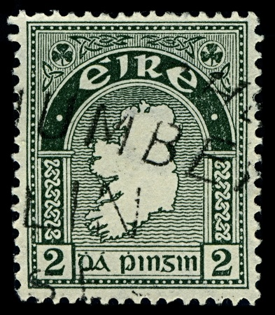 IRELAND-CIRCA 1922:A stamp printed in IRELAND shows image of National symbols Ireland Map, circa 1922.
