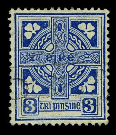 combines: IRELAND-CIRCA 1922:A stamp printed in IRELAND shows image of Celtic cross  is a symbol that combines a cross with a ring surrounding the intersection, circa 1922.