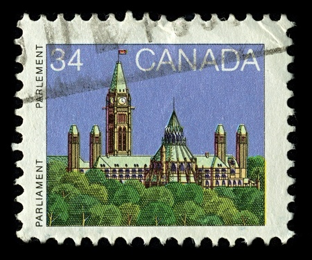 CANADA-CIRCA 1985:A stamp printed in CANADA shows image of the Parliament of Canada  is the federal legislative branch of Canada, seated at Parliament Hill in the national capital, Ottawa, circa 1985. Stock Photo - 10678444
