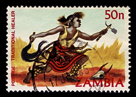 Zambia-CIRCA 1981:A stamp printed in Zambia shows image of Medicine man  are English term used to describe traditional healers and spiritual leaders among Native American and other indigenous or aboriginal peoples, circa 1981.
