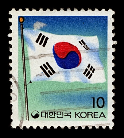 Korea-CIRCA 1993:A stamp printed in Korea shows image of The flag of South Korea, or Taegeukgi has three parts: a white background; a red and blue taegeuk in the centre; and four black trigrams, one in each corner of the flag, circa 1993. Stock Photo - 10752964