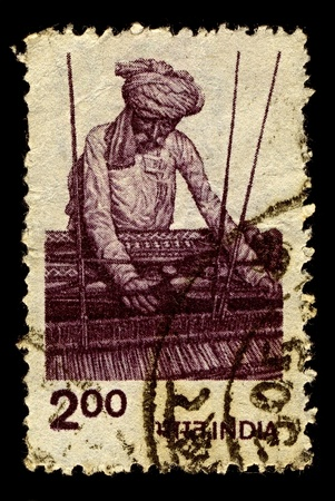 machinetool: India-CIRCA 1980:A stamp printed in India shows image of A loom is a device used to weave cloth, circa 1980.