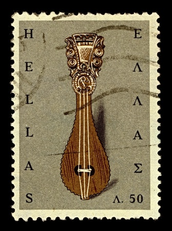 Greece-CIRCA 1966:A stamp printed in Greece shows image of The Cretan lyra is a Greek pear-shaped, three-stringed bowed musical instrument, central to the traditional music of Crete, circa 1966.