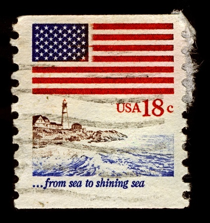 signifier: USA-CIRCA 1981:A stamp printed in USA shows image of Flag, Lighthouse, circa 1981.