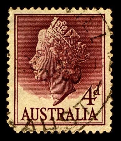 alexandra: Australia-CIRCA 1957:A stamp printed in Australia shows image of Elizabeth II (Elizabeth Alexandra Mary, born 21 April 1926) is the constitutional monarch of United Kingdom, circa 1957. Editorial