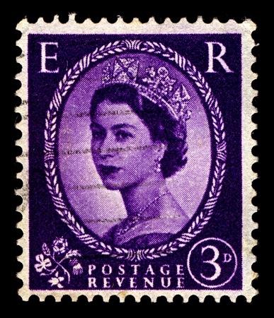 alexandra: United Kingdom-CIRCA 1952:A stamp printed in United Kingdom shows image of Elizabeth II (Elizabeth Alexandra Mary) is the constitutional monarch of United Kingdom in violet, circa 1952.