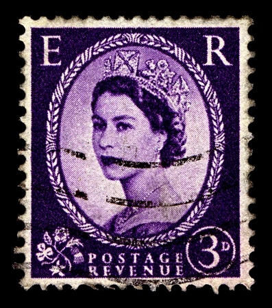 alexandra: United Kingdom-CIRCA 1952:A stamp printed in United Kingdom shows image of Elizabeth II (Elizabeth Alexandra Mary) is the constitutional monarch of United Kingdom in violet, circa 1952.