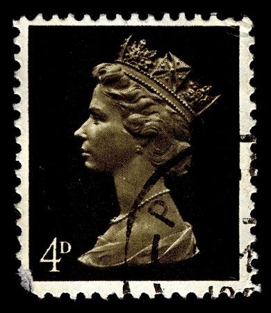 alexandra: United Kingdom-CIRCA 1967:A stamp printed in United Kingdom shows image of Elizabeth II (Elizabeth Alexandra Mary) is the constitutional monarch of United Kingdom in black, circa 1967.