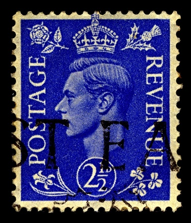 dominions: United Kingdom-CIRCA 1937:A stamp printed in United Kingdom shows image of George VI (Albert Frederick Arthur George) was King of the United Kingdom and the Dominions of the British Commonwealth, circa 1937. Editorial