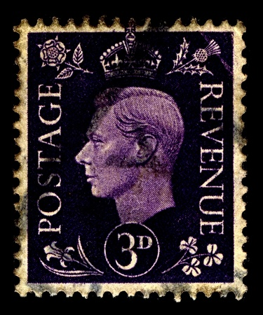 dominions: United Kingdom-CIRCA 1941:A stamp printed in United Kingdom shows image of George VI (Albert Frederick Arthur George) was King of the United Kingdom and the Dominions of the British Commonwealth, circa 1941.