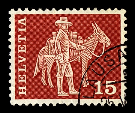 bod: Switzerland-CIRCA 1963:A stamp printed in Switzerland shows image of hem with mule, circa 1963. Editorial