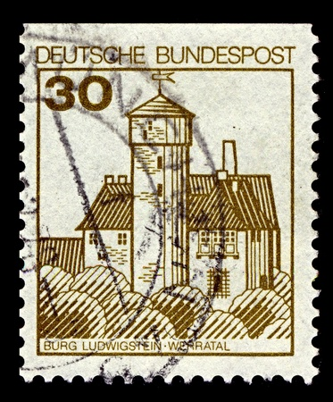 beautiful woodland: Germany-CIRCA 1977:A stamp printed in Germany shows image of Burg Ludwigstein is a 15th-century castle overlooking the river Werra and surrounded by beautiful woodland. circa 1977.