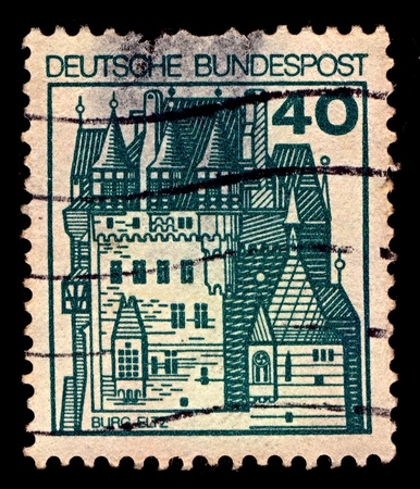 Germany-CIRCA 1977:A stamp printed in Germany shows image of Burg Eltz is a medieval castle nestled in the hills above the Moselle River between Koblenz and Trier, Germany, circa 1977.